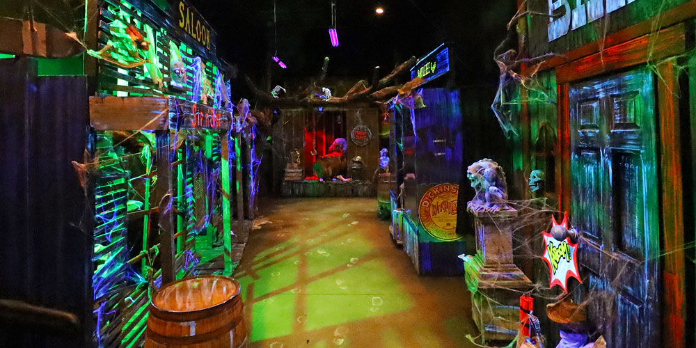 Morbid Meridian Street, including displays of a bank and saloon inside the Frightful Frontier Haunted House at The Children's Museum of Indianapolis.