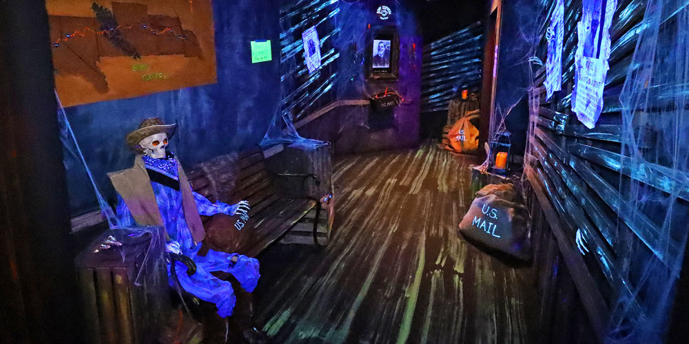Cowboy skeleton and mailbags inside Bony Express room in the Frightful Frontier Haunted House at The Children's Museum of Indianapolis.
