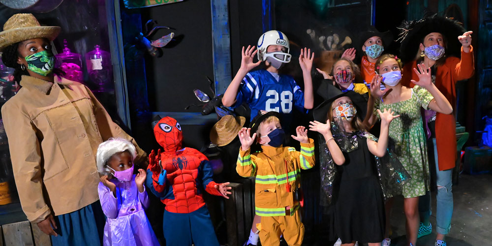 People wearing costumes at The Children's Museum Guild's Annual Haunted House