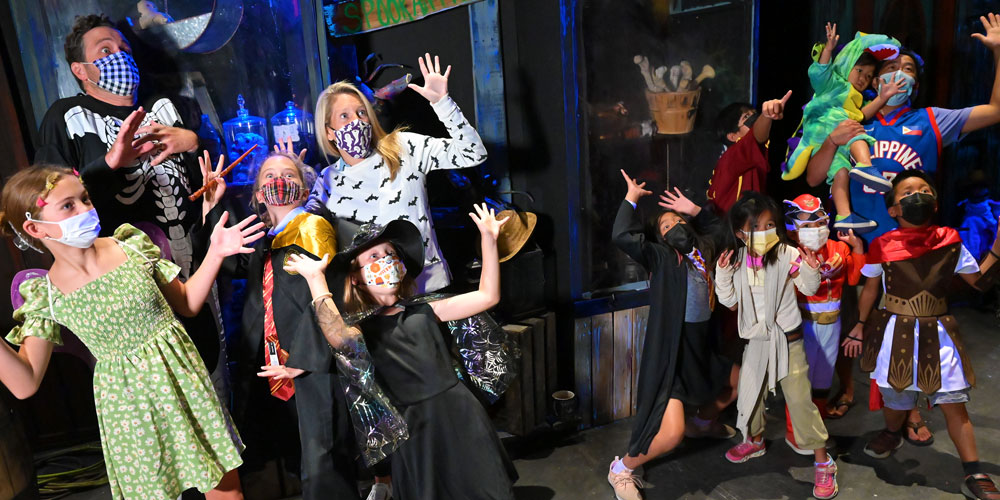 Crowd wearing costumes at The Children's Museum Guild's Annual Haunted House