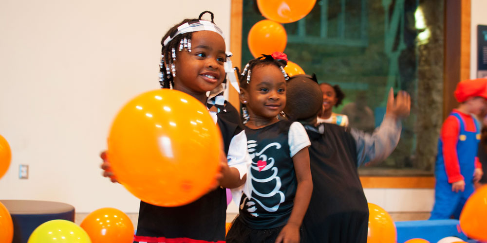 Children playing with big balloons at the Indiana State Museum's Family Fright Night